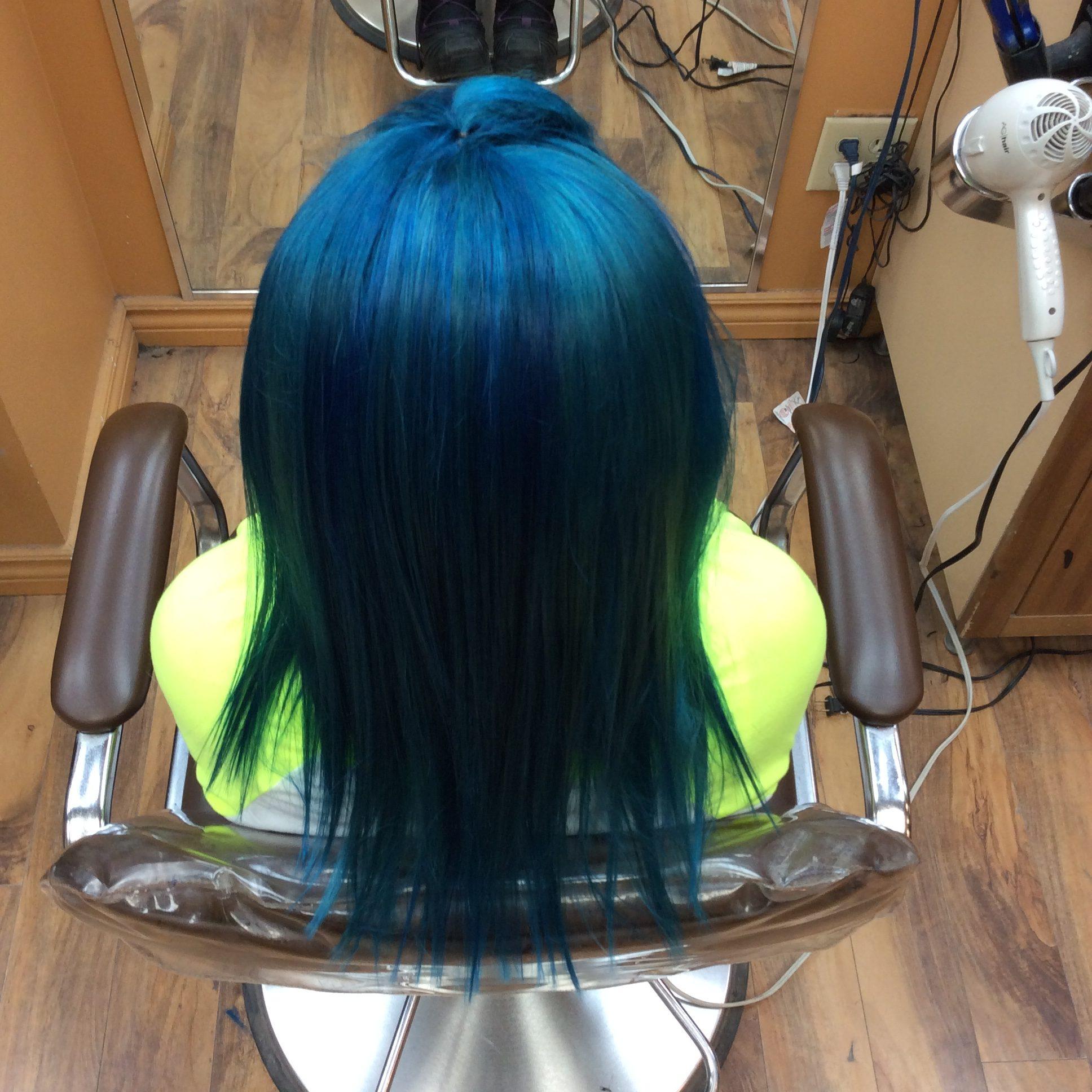 Female customer with long blue hair style at hairstyle inn saskatoon