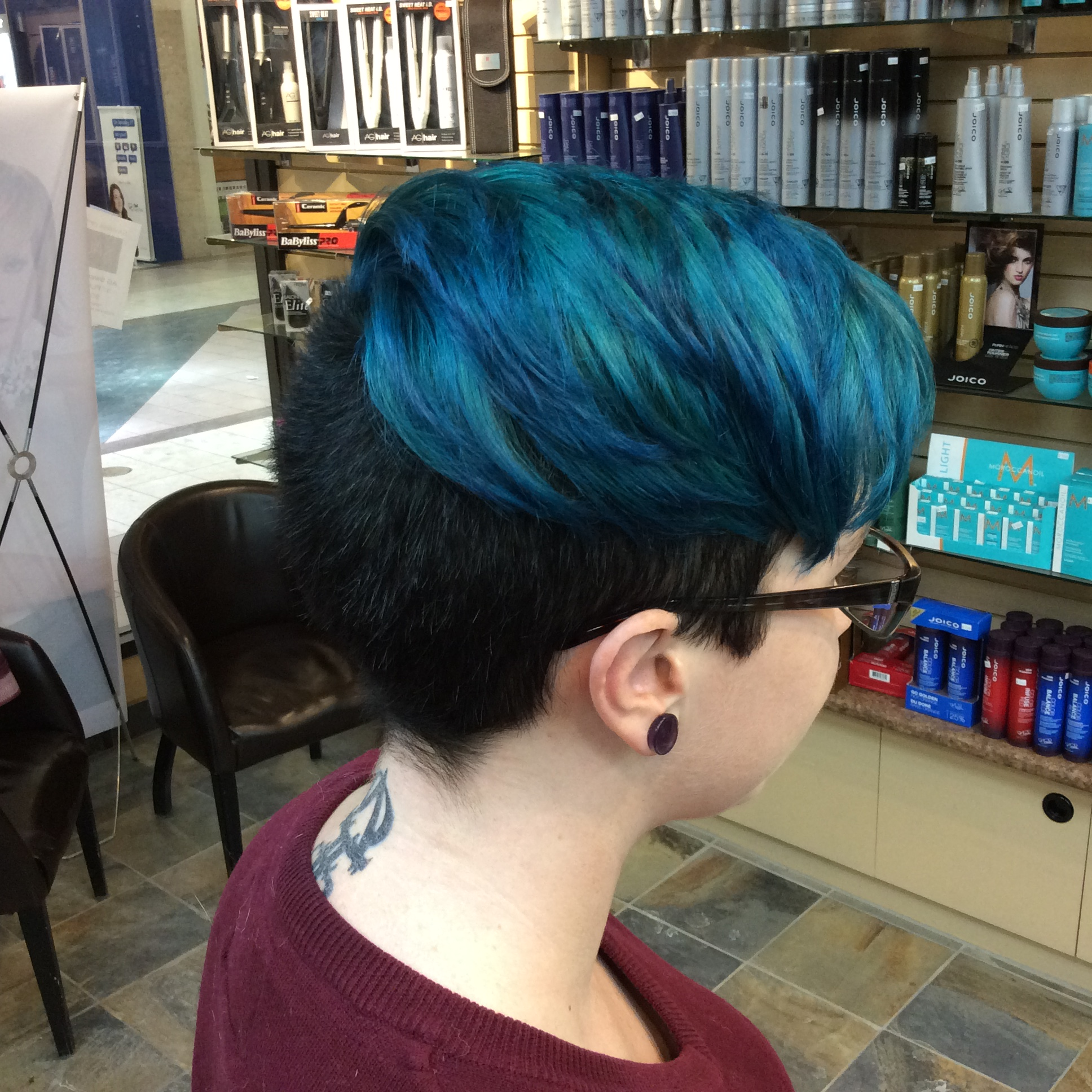 Female customer with blue short haircut at hairstyle inn saskatoon