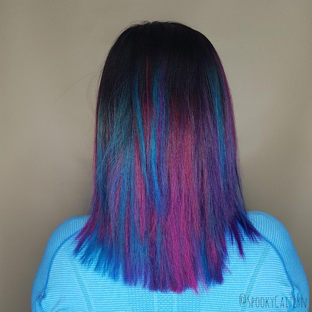 Female customer with blue magenta hair style at hairstyle inn saskatoon