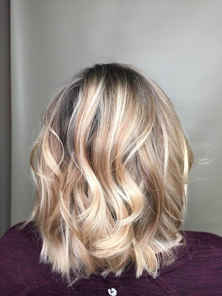 Female with blunt blonde hair style at hairstyle inn saskatoon