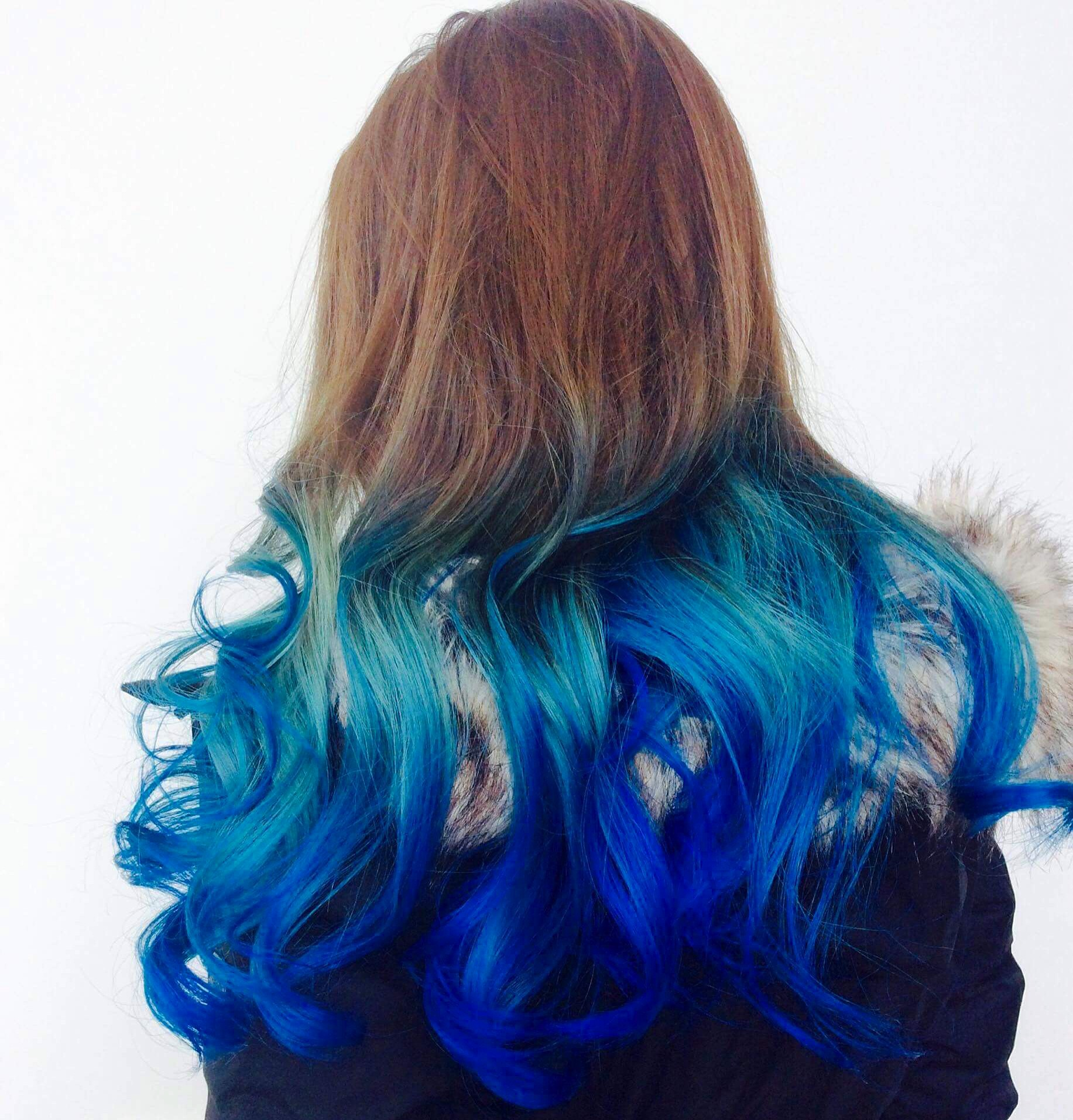 Back view of female model with brown aqua blue ombre hair at hairstyle inn Saskatoon