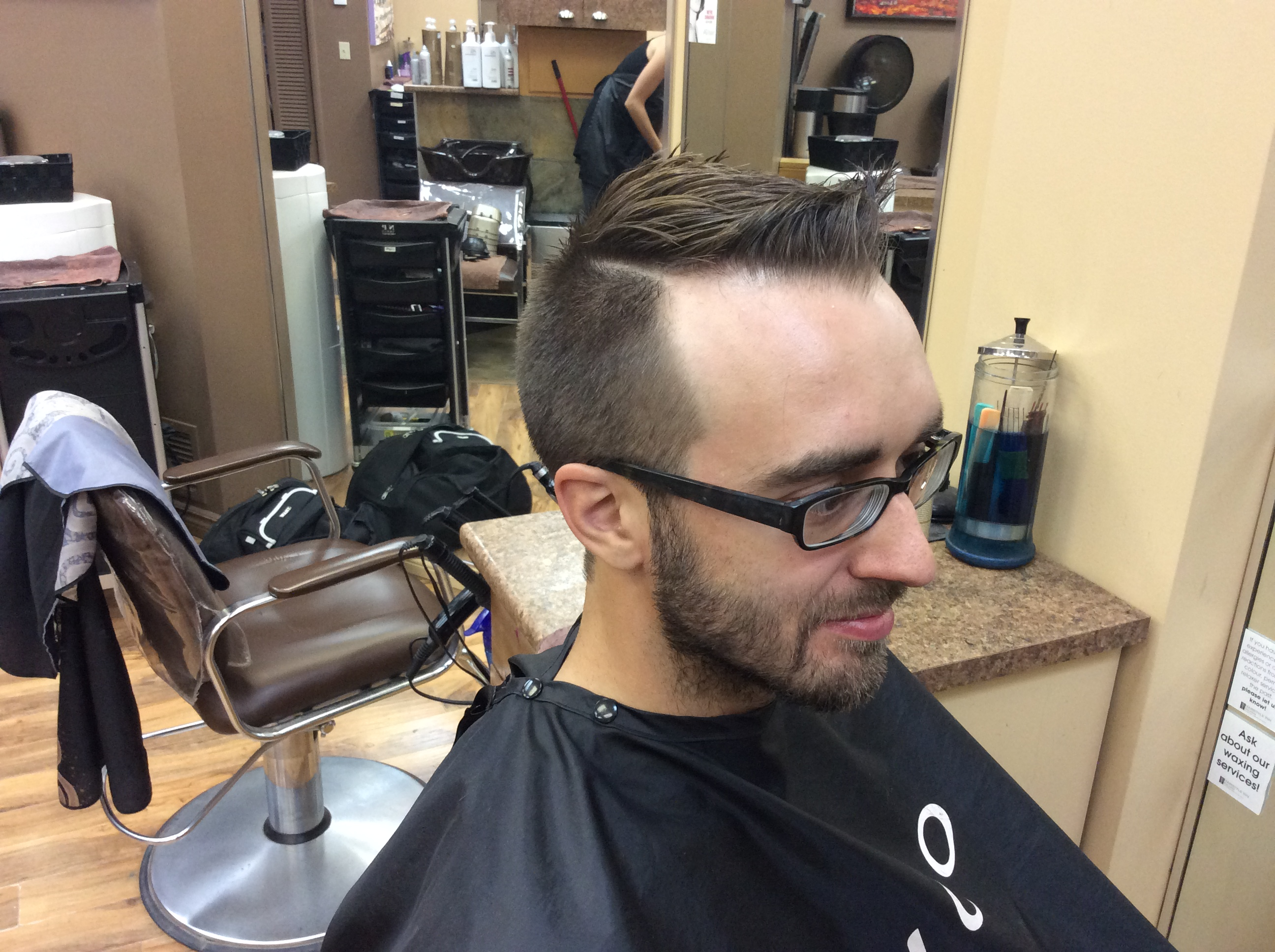 Side view of a male customer's haircut at hairstyle inn Saskatoon