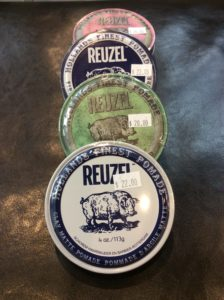 Reuzel hair products displayed at hairstyle inn Saskatoon