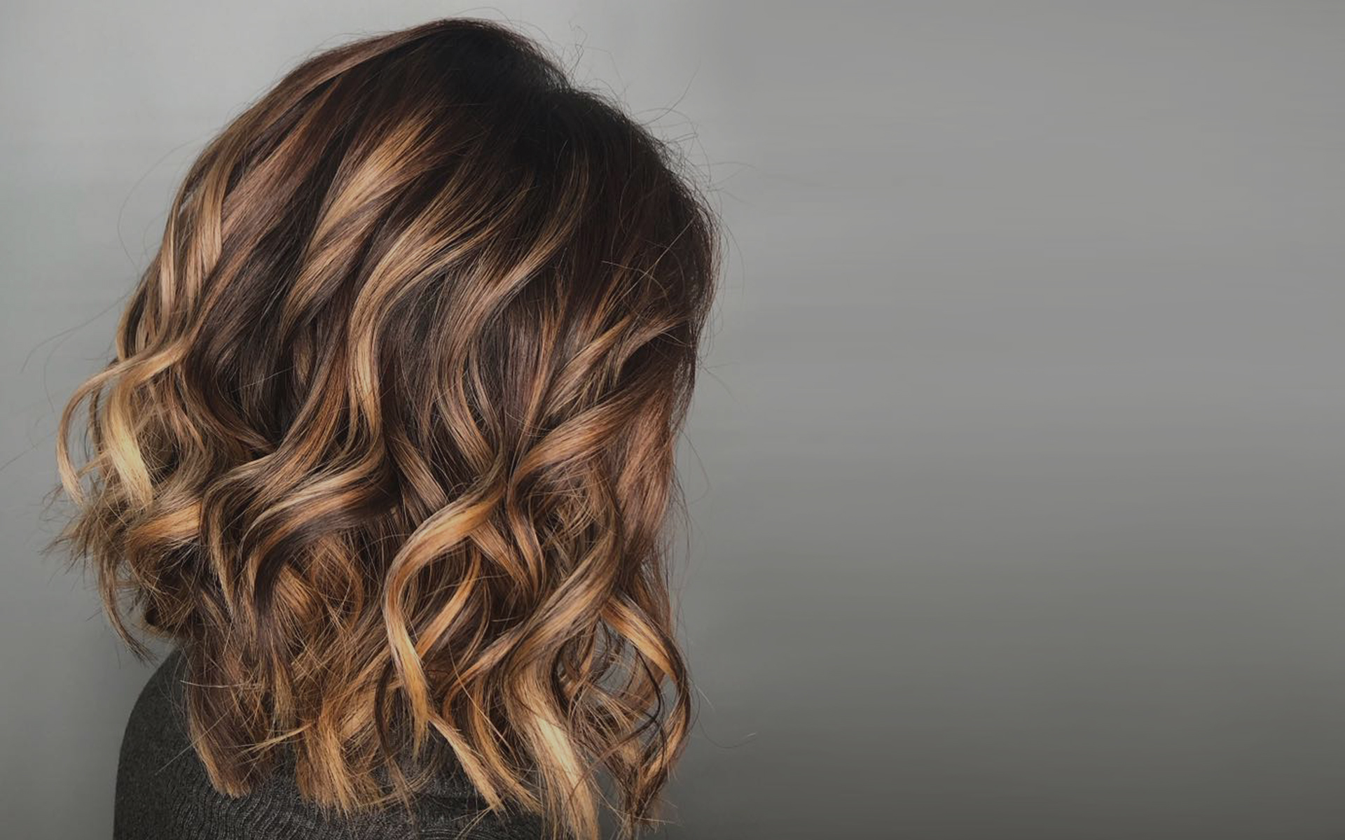 Female customer with curly highlights hair Saskatoon