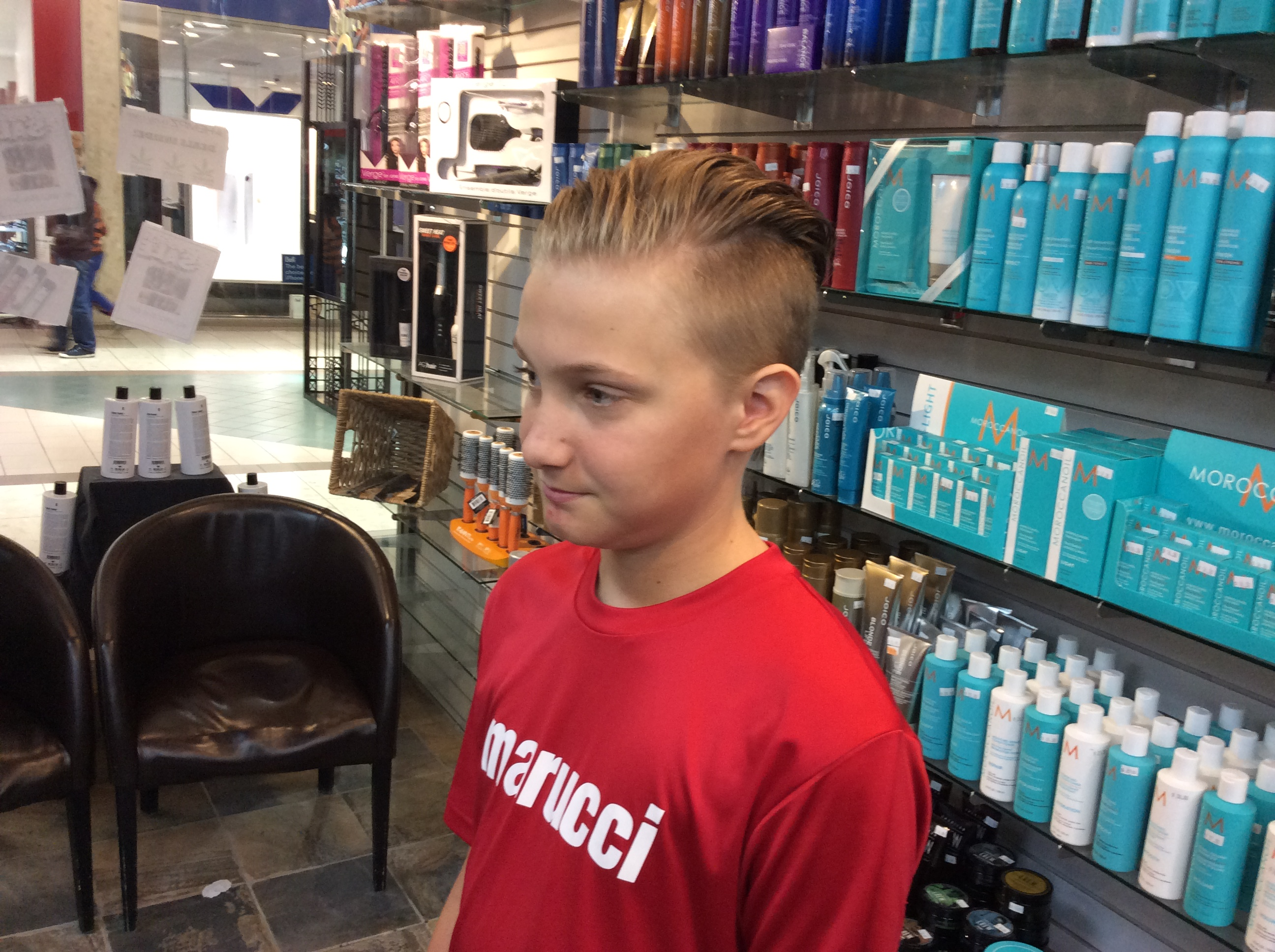 Young boy with haircut for boys at Hairstyle Inn