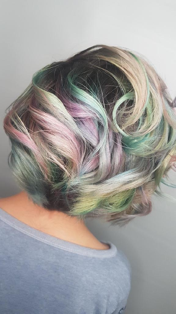 Back view of young girl with pastel colour hair style
