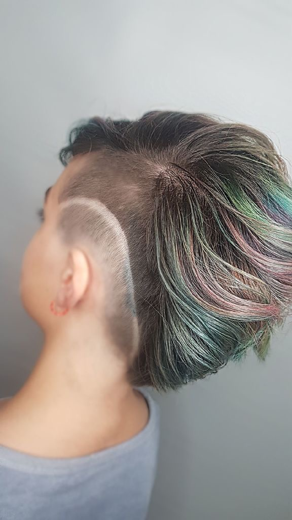 Young girl with tatooed hair cut at Hairstyle Inn