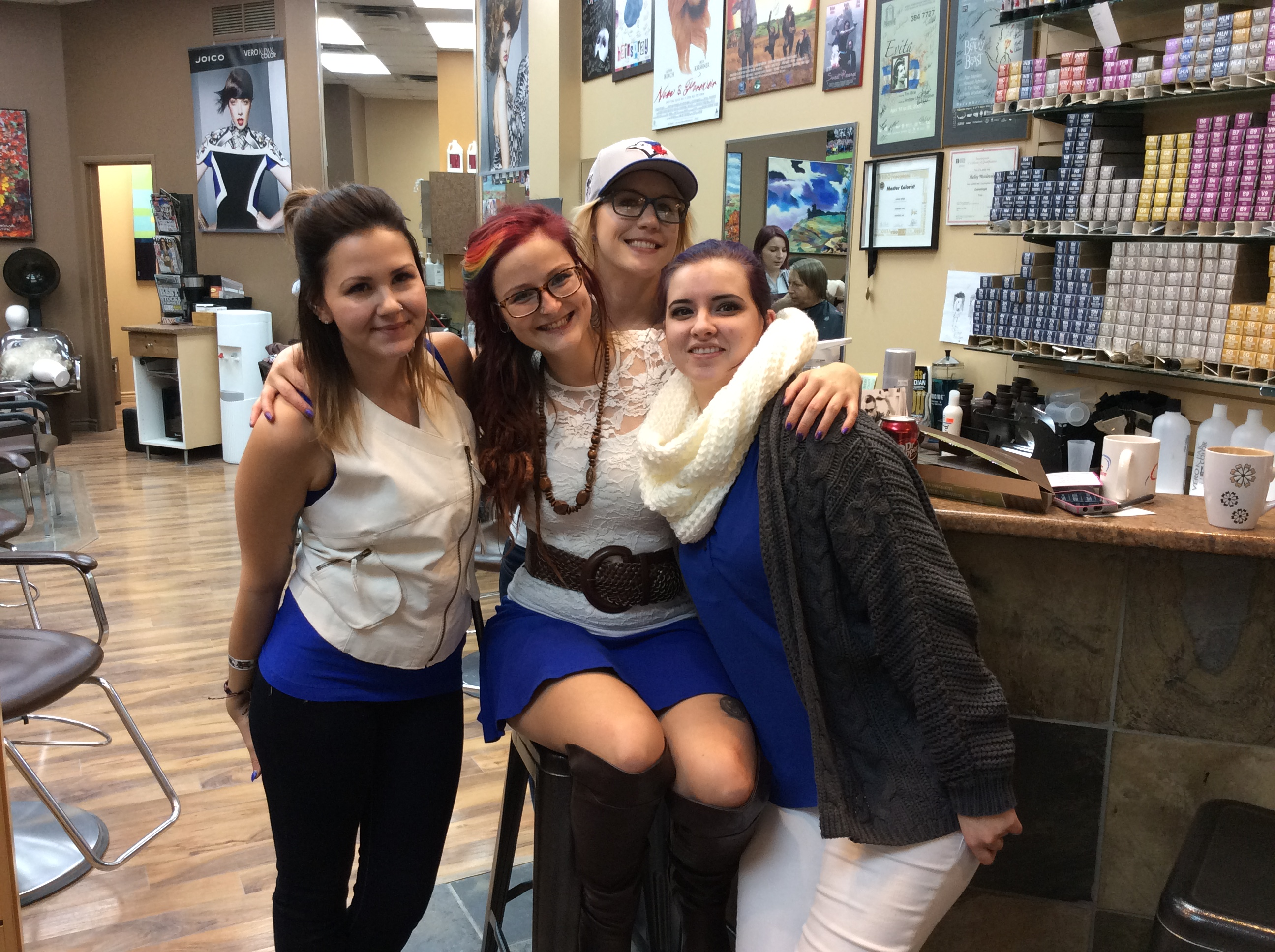 Stylists at Hairstyle Inn dressed in blue and white