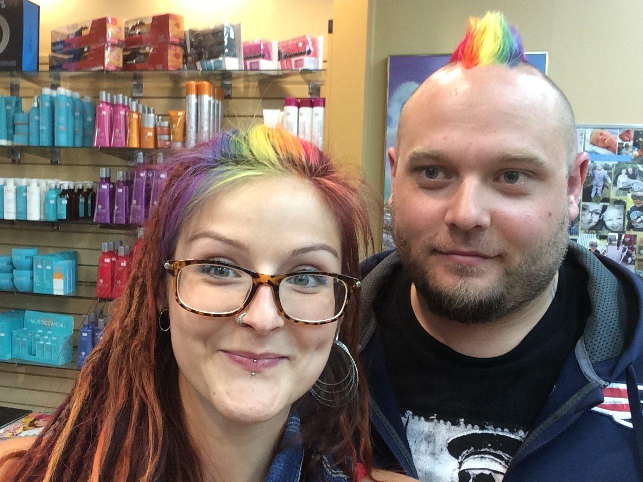 Couple with rainbow colour hair styles at Hairstyle Inn