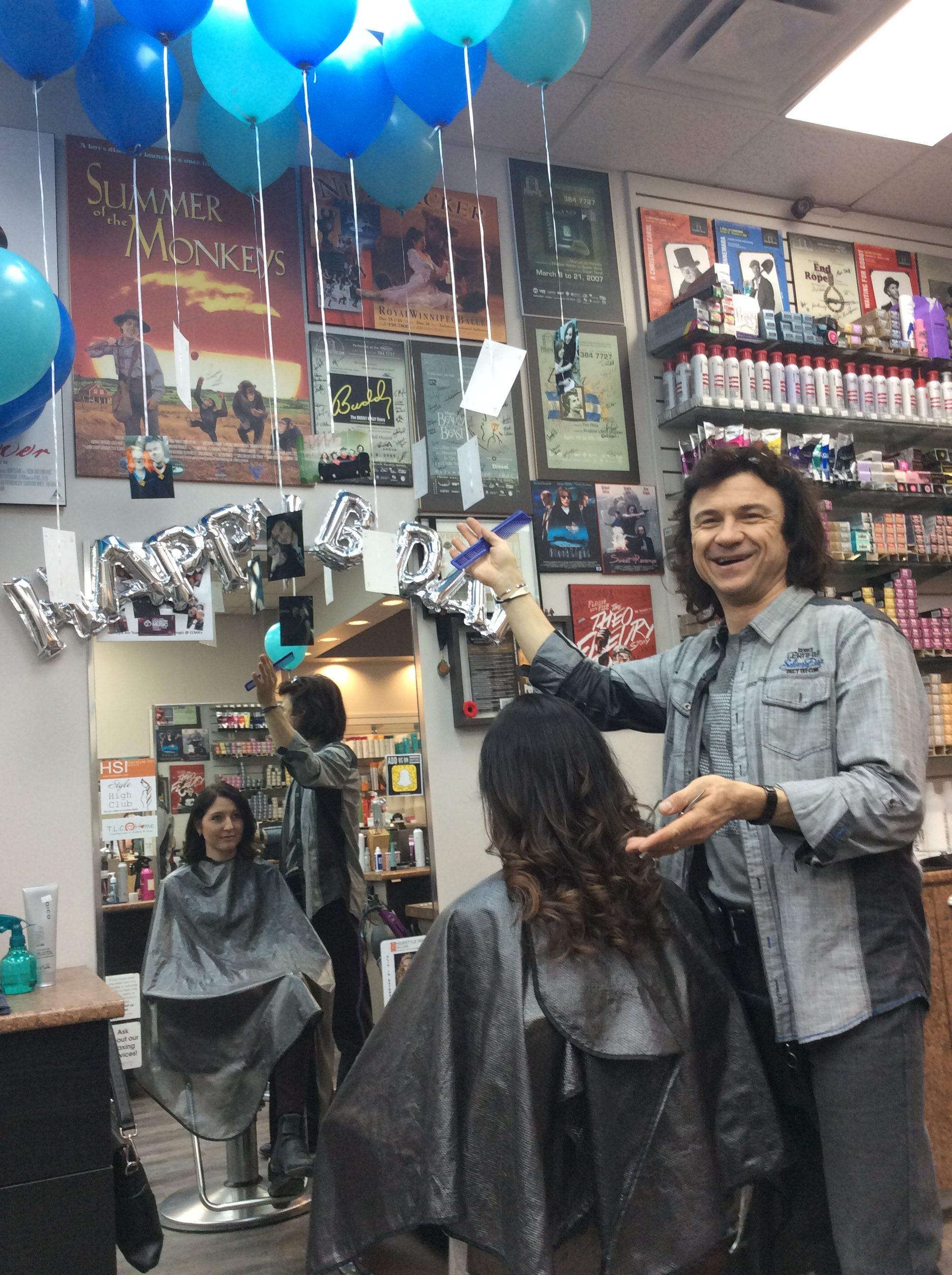 Blue balloons and birthday decoration at hairstyle inn saskatoon